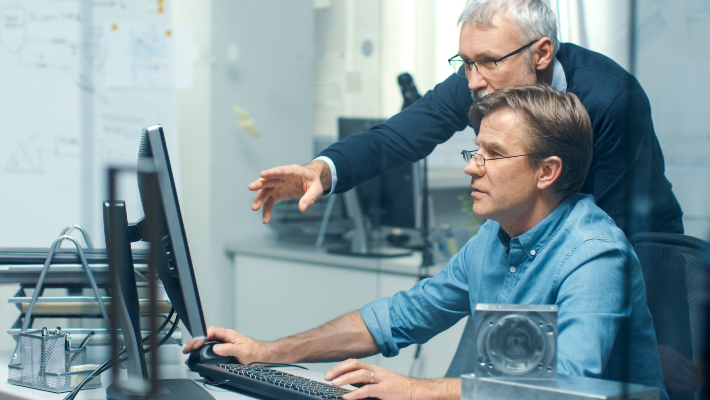 Engineers looking at a computer
